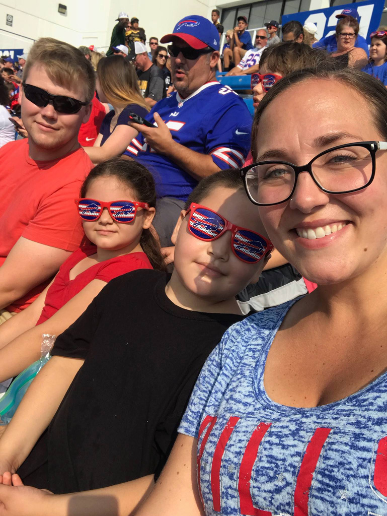 friends enjoying day at the game