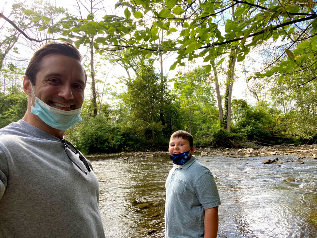 Volunteer and friend at the creek